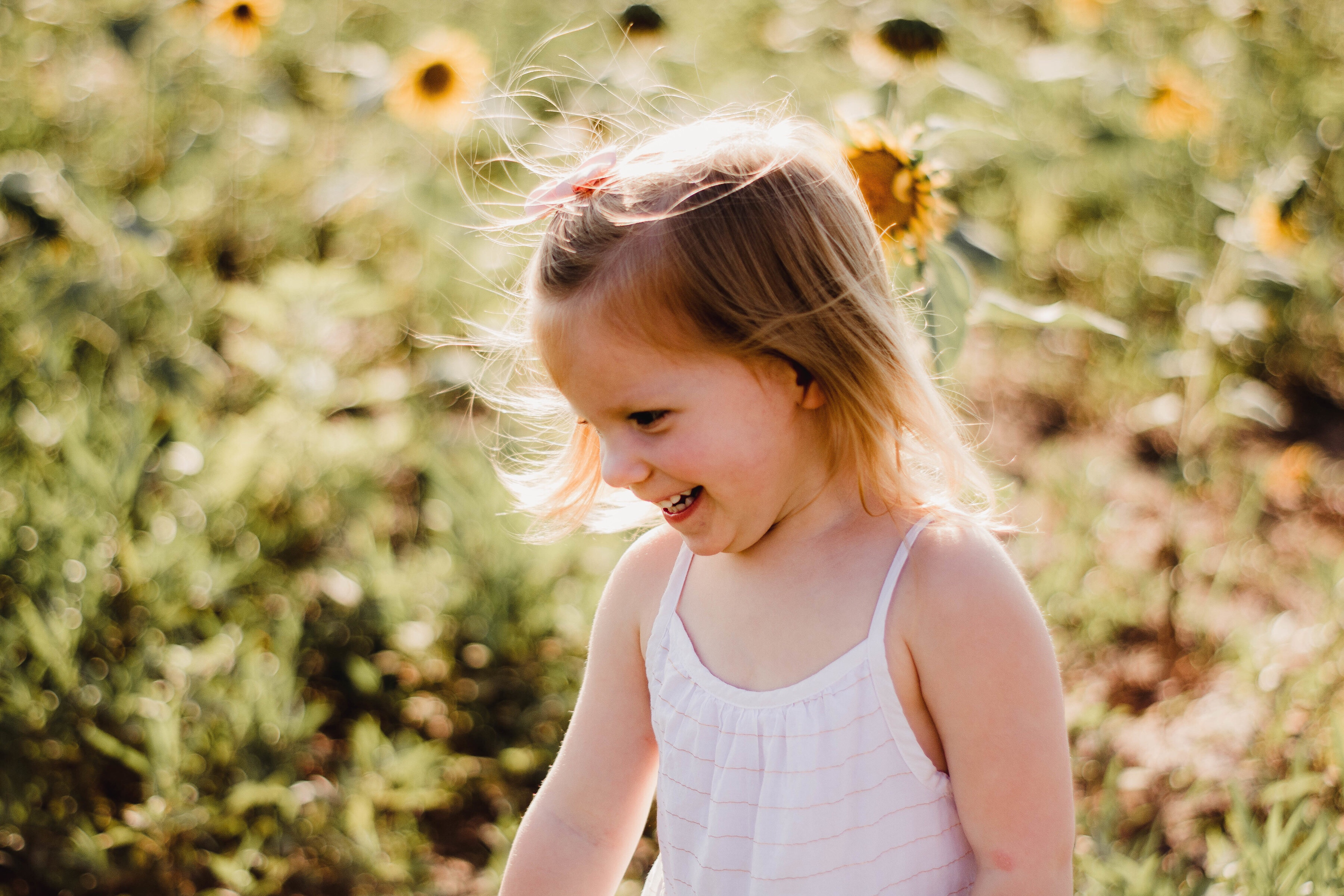 Toddler smiling in sunflower field